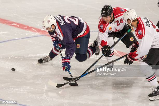 Stefan Matteau of Team USA falls after a contest with Adam Cracknell of Team Canada and Peter Holland of Team Canada during the Melbourne Game of the...