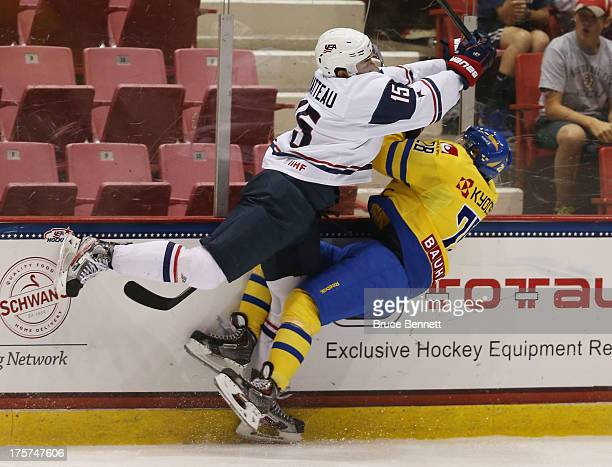 Stefan Matteau of Team USA takes a roughing penalty on Lucas Wallmark of Team Sweden during the 2013 USA Hockey Junior Evaluation Camp at the Lake...