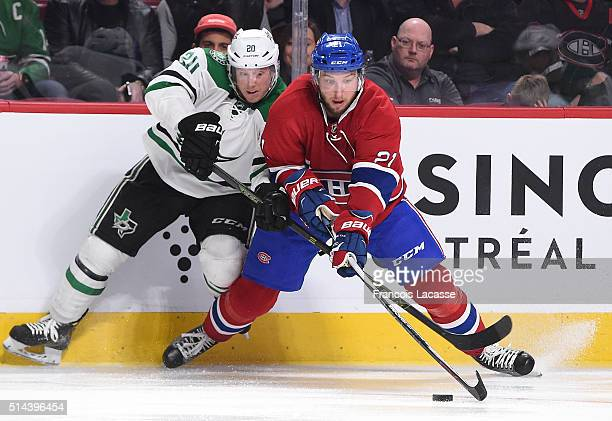 Stefan Matteau of the Montreal Canadiens and Cody Eakin of the Dallas Stars fight for the puck in the NHL game at the Bell Centre on March 8 2016 in...