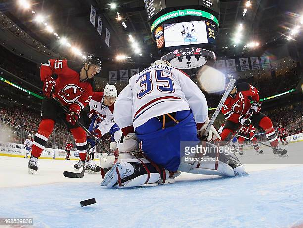 Stefan Matteau of the New Jersey Devils l0 scores a first period goal against Dustin Tokarski of the Montreal Canadiens at the Prudential Center on...