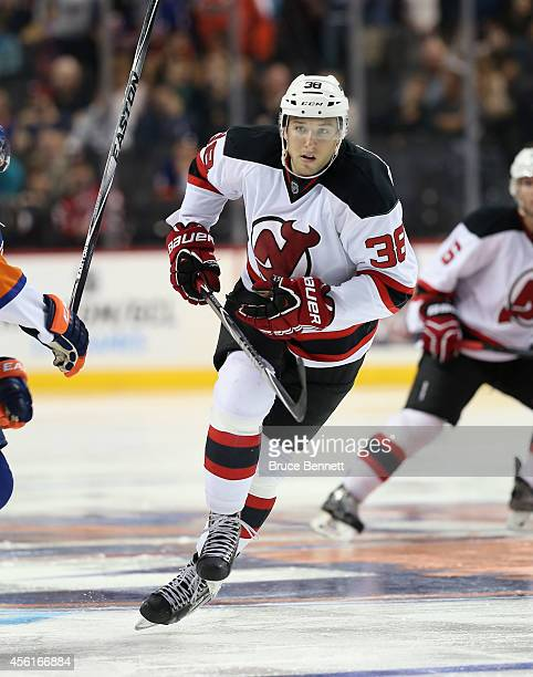 Stefan Matteau of the New Jersey Devils skates against the New York Islanders at the Barclays Center on September 26 2014 in the Brooklyn borough of...