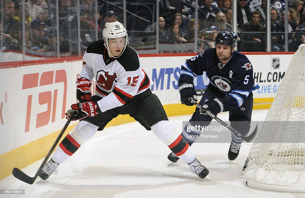<a gi-track='captionPersonalityLinkClicked' href=/galleries/search?phrase=Stefan+Matteau&family=editorial&specificpeople=9480769 ng-click='$event.stopPropagation()'>Stefan Matteau</a> #15 of the New Jersey Devils skates around the net as Mark Stuart #5 of the Winnipeg Jets gives chase during third-period action at the MTS Centre on February 28, 2013 in Winnipeg, Manitoba, Canada. The Jets defeated the Devils 3-1.