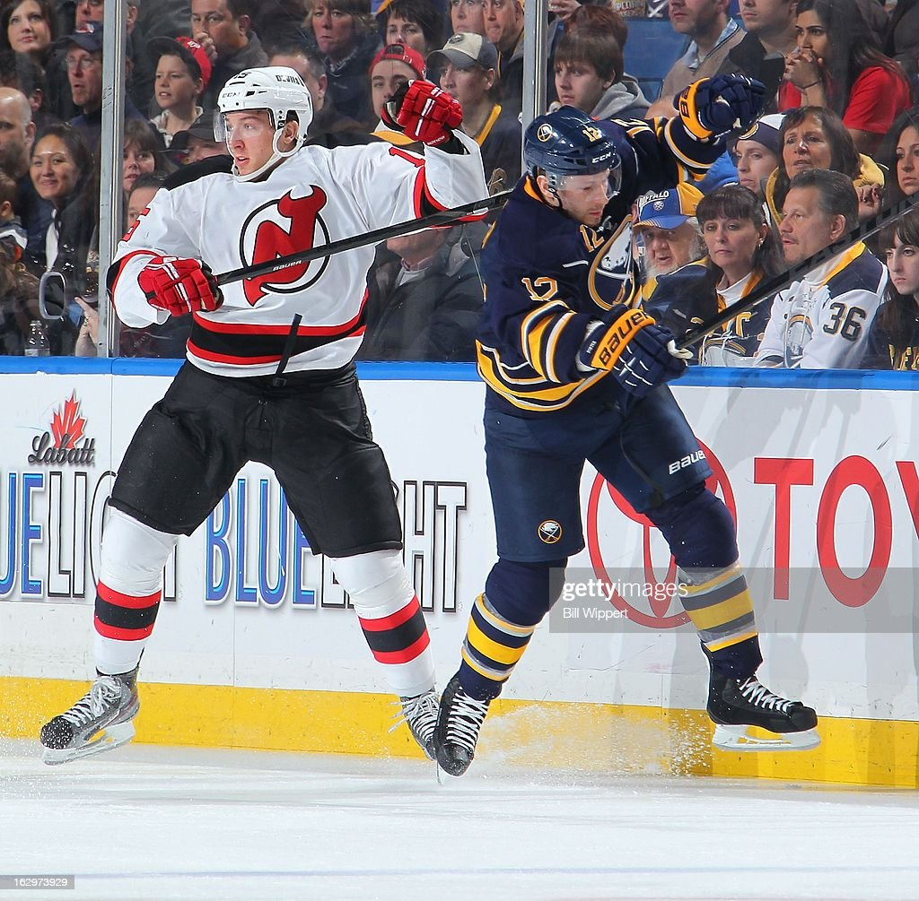Stefan Matteau #15 of the New Jersey Devils takes a step over to avoid the check from Kevin Porter #12 of the Buffalo Sabres on March 2, 2013 at the First Niagara Center in Buffalo, New York.