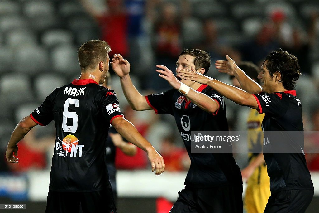 Stefan Mauk of Adelaide United celebrates his goal with <a gi-track='captionPersonalityLinkClicked' href=/galleries/search?phrase=Craig+Goodwin&family=editorial&specificpeople=8749472 ng-click='$event.stopPropagation()'>Craig Goodwin</a> during the round 19 A-League match between the Central Coast Mariners and Adelaide United at Central Coast Stadium on February 14, 2016 in Gosford, Australia.