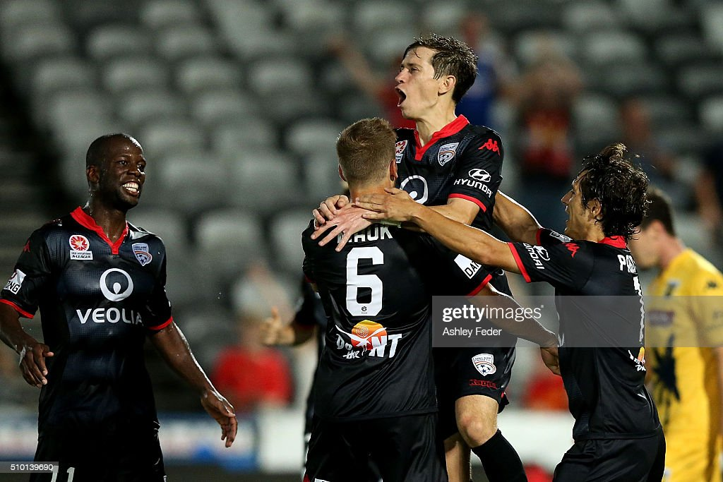 Stefan Mauk of Adelaide United celebrates his goal with Mariners players looking dejected in frame during the round 19 A-League match between the Central Coast Mariners and Adelaide United at Central Coast Stadium on February 14, 2016 in Gosford, Australia.
