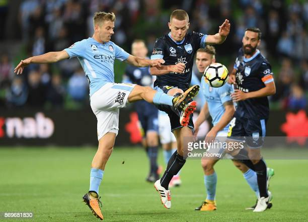 Stefan Mauk of the City and Brandon O'Neill of Sydney FC compete for the ball during the round five ALeague match between Melbourne City FC and...