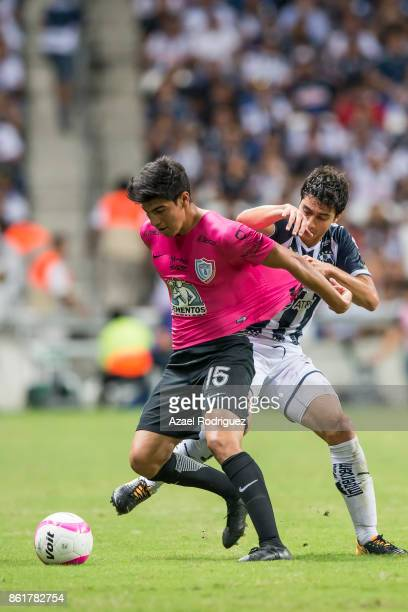 Stefan Medina of Monterrey fights for the ball with Erick Gutierrez of Pachuca during the 13th round match between Monterrey and Pachuca as part of...