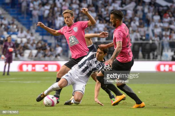 Stefan Medina of Monterrey fights for the ball with Keisuke Honda and Robert Herrera of Pachuca during the 13th round match between Monterrey and...