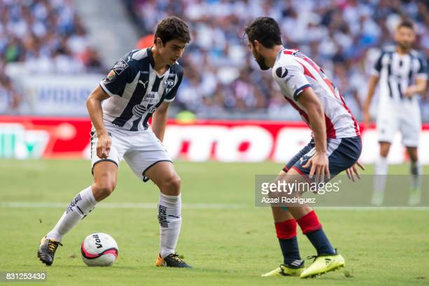Stefan Medina of Monterrey fights for the ball with Rodolfo Pizarro of Chivas during the 4th round match between Monterrey and Chivas as part of the...