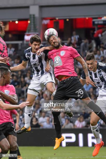 Stefan Medina of Monterrey heads the ball with Robert Herrera of Pachuca during the 13th round match between Monterrey and Pachuca as part of the...
