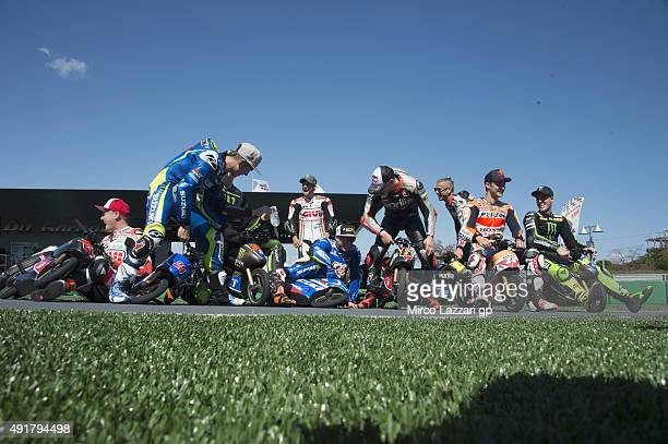 Stefan MotoGP Riders pose and joke during the preevent 'Tiny electronic mini bikes race' during the MotoGP Of Japan Previews at Twin Ring Motegi on...