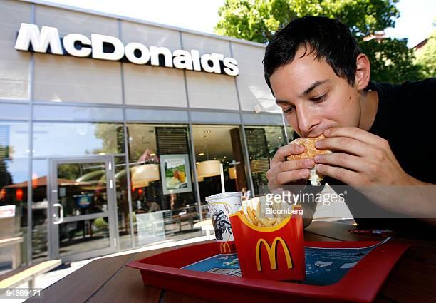 Stefan Nicola eats a Big Mac hamburger at a McDonald's fastfood restaurant franchise in the Kreuzberg neighborhood of Berlin Germany on Monday July...