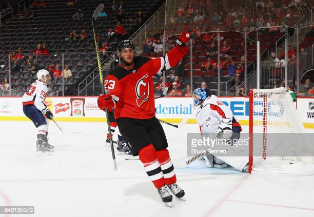 Stefan Noesen of the New Jersey Devils celebrates his goal at 140 of the second period against Vitek Vanecek of the Washington Capitals during a...