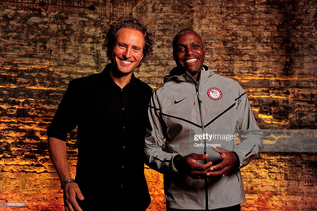 Stefan Olander (Vice President of Digital Sport) poses with US track and field legend Carl Lewis who wears Nike's Medal Stand jacket, which will be worn by successful athletes of Nike sponsored Federations. Carl Lewis attended the launch of Nike's innovations for this summer, which showcased key technological advances in footwear and apparel. The launch of Nike's innovations for this summer took place at the Farmiloe Building on July 9, 2012 in London, England. www.nikeinc.com.