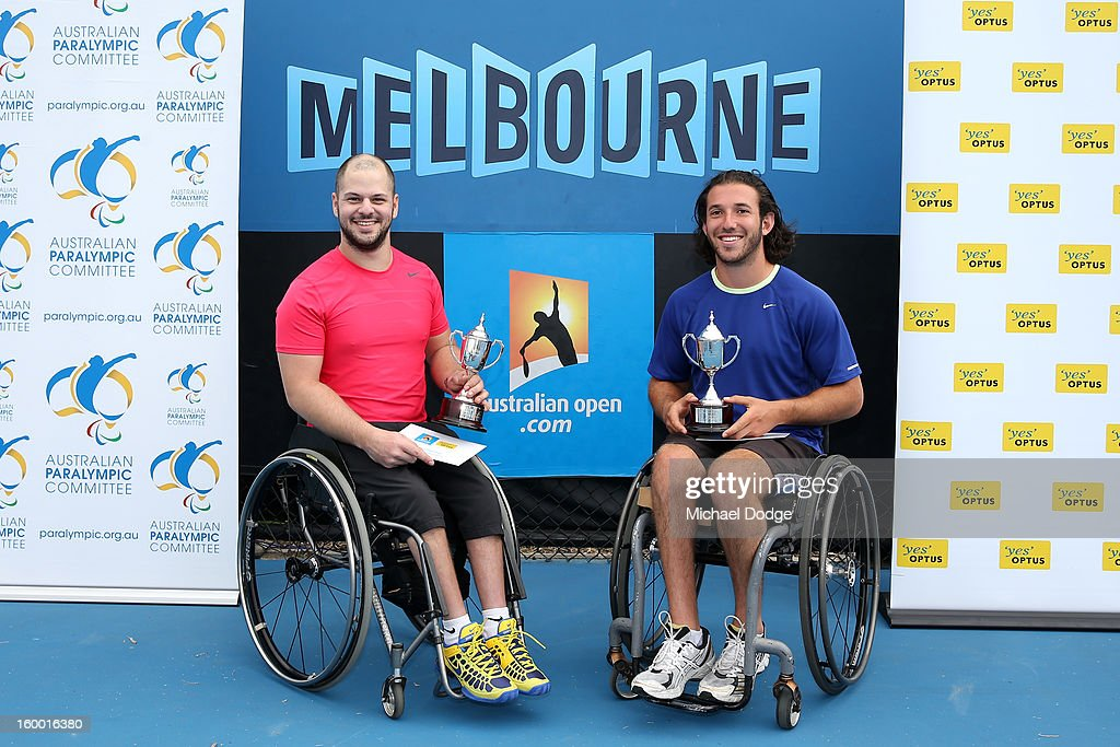 Stefan Olsson (L) of Sweden and Adam Kellerman of Australia celebrate with their runners up trophy after losing their Wheelchair Doubles Final against Michael Jeremiasz of France and Shingo Kunieda of Japan at Melbourne Park on January 25, 2013 in Melbourne, Australia.