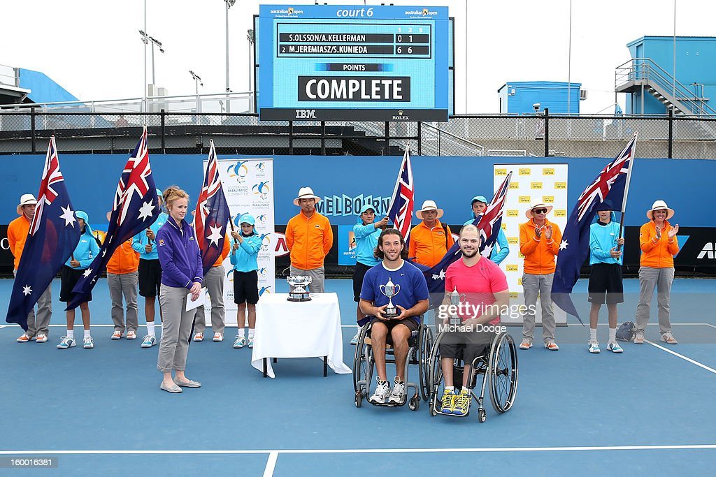 Stefan Olsson (R) of Sweden and Adam Kellerman of Australia celebrate with their runners up trophy after losing their Wheelchair Doubles Final against Michael Jeremiasz of France and Shingo Kunieda of Japan at Melbourne Park on January 25, 2013 in Melbourne, Australia.