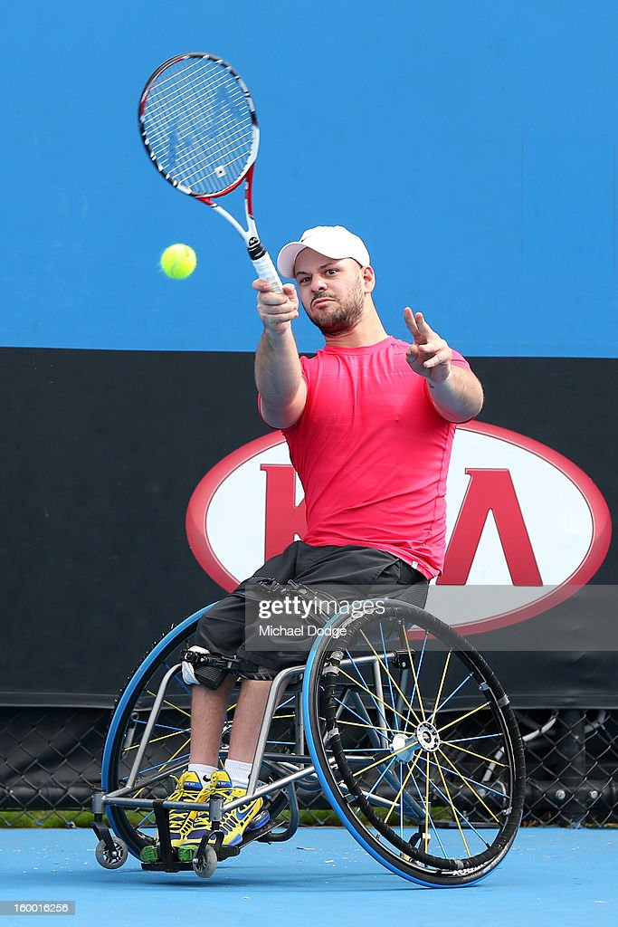 Stefan Olsson of Sweden plays a shot in his Wheelchair Doubles Final with Adam Kellerman of Australia against Michael Jeremiasz of France and Shingo Kunieda of Japan at Melbourne Park on January 25, 2013 in Melbourne, Australia.