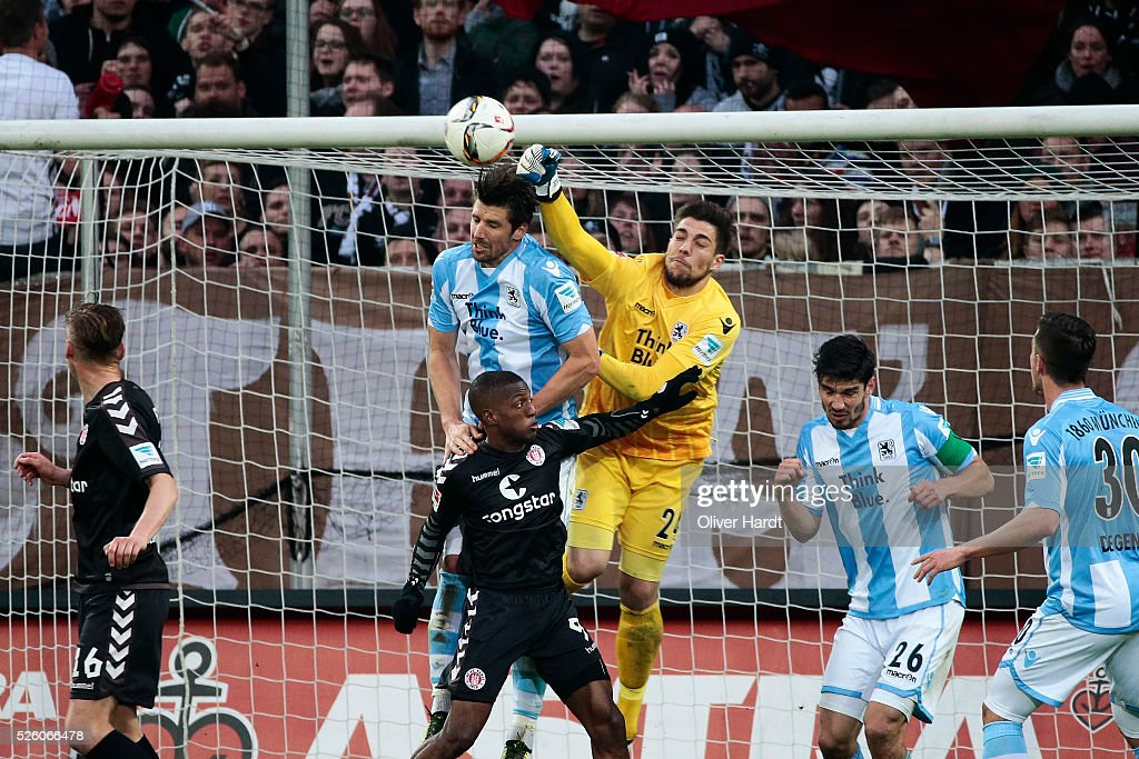Stefan Ortega Moreno (C) of Hamburg and Fafa Picault (L) of Muenchen compete for the ball during the Second Bundesliga match between FC St. Pauli and 1860 Muenchen at Millerntor Stadium on April 29, 2016 in Hamburg, Germany.