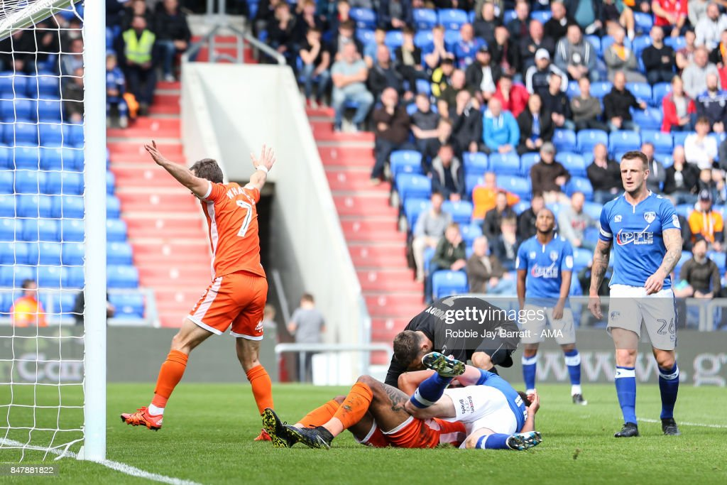 Stefan Payne of Shrewsbury Town stays down injured after he scores a goal to make it 0-1 during the Sky Bet League One match between Oldham Athletic and Shrewsbury Town at Boundary Park on September 16, 2017 in Oldham, England.