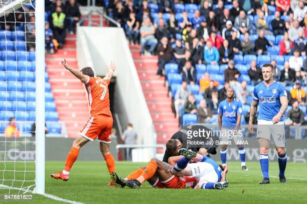 Stefan Payne of Shrewsbury Town stays down injured after he scores a goal to make it 01 during the Sky Bet League One match between Oldham Athletic...