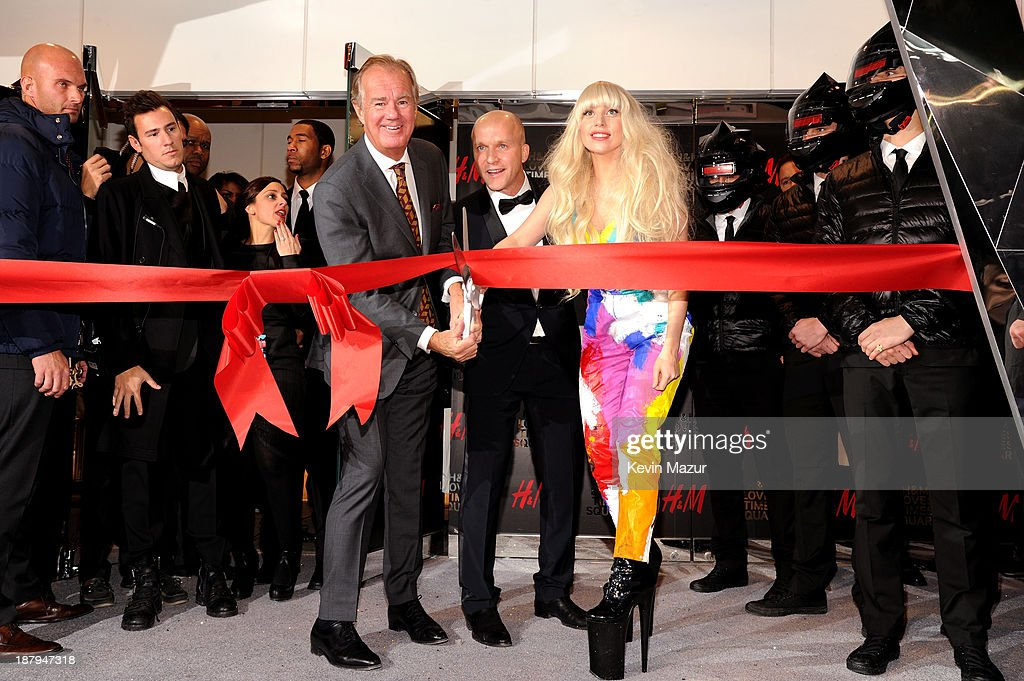 Stefan Persson, Daniel Kulle and Lady Gaga cut the ribbon to open an epic H&M store in Times Square on November 13, 2013 in New York City.