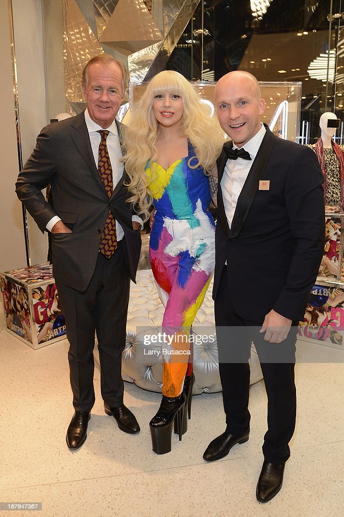 Stefan Persson, Lady Gaga and Daniel Kulle pose inside the new epic H&M store in Times Square on November 13, 2013 in New York City.