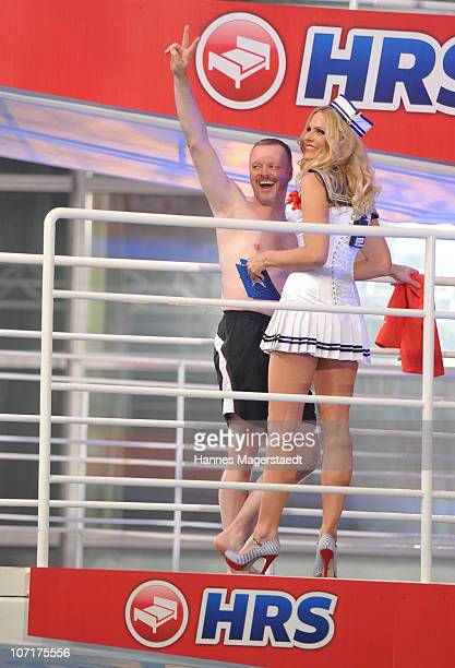 Stefan Raab and Sonya Kraus pose during the TV Total Turmspringen TV Show at the Munich Olympiaschwimmhalle on November 27 2010 in Munich Germany