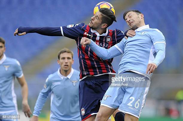 Stefan radu of SS Lazio compete for the ball with Diego Falcinelli of FC Crotone during the Serie A match between SS Lazio and FC Crotone at Stadio...