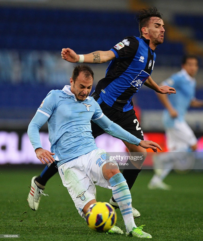 <a gi-track='captionPersonalityLinkClicked' href=/galleries/search?phrase=Stefan+Radu&family=editorial&specificpeople=4050253 ng-click='$event.stopPropagation()'>Stefan Radu</a> (L) of S.S. Lazio competes for the ball with <a gi-track='captionPersonalityLinkClicked' href=/galleries/search?phrase=Luca+Cigarini&family=editorial&specificpeople=3933790 ng-click='$event.stopPropagation()'>Luca Cigarini</a> of Atalanta BC during the Serie A match between S.S. Lazio and Atalanta BC at Stadio Olimpico on January 13, 2013 in Rome, Italy.