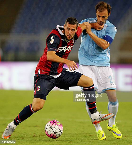 Stefan Radu of SS Lazio competes for the ball with Mattia Destro of Bologna FC during the Serie A match between SS Lazio and Bologna FC at Stadio...