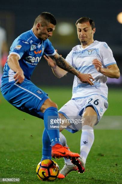 Stefan Radu of SS Lazio competes for the ball with Omas El Kaddouri of Empoli FC during the Serie A match between Empoli FC and SS Lazio at Stadio...