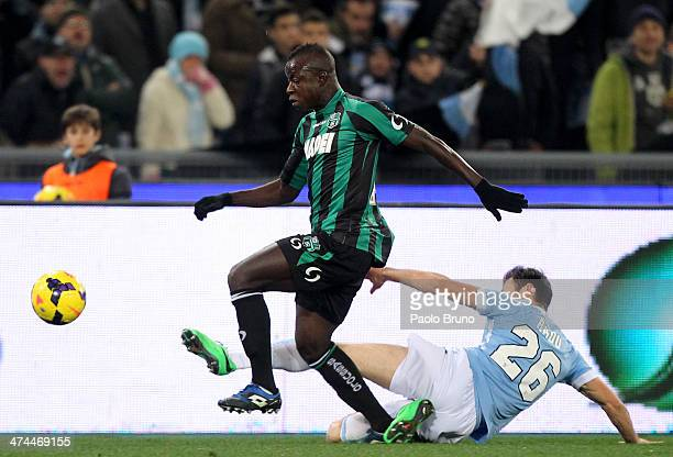 Stefan Radu of SS Lazio competes for the ball with Yussif Chibsah of US Sassuolo Calcio during the Serie A match between SS Lazio and US Sassuolo...