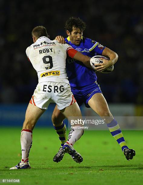 Stefan Ratchford of Warrington Wolves is tackled James Roby of St Helens during the First Utility Super League Semi Final match between Warrington...