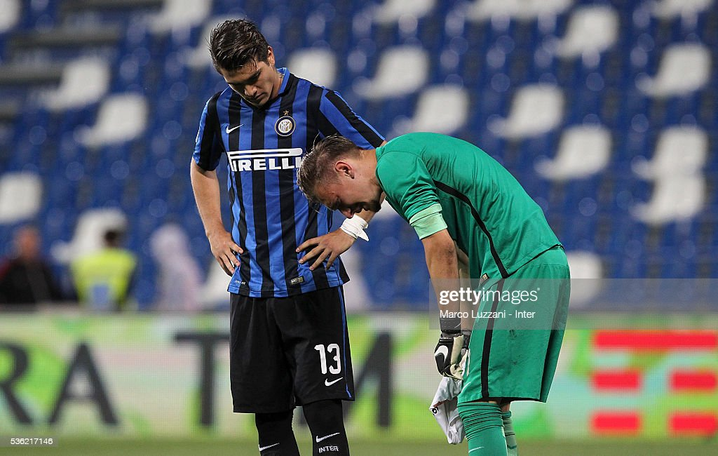Stefan Razvan Popa (L) and Iontu Andrei Radu of FC Internazionale show their dejection at the end of the juvenile playoff match between FC Internazionale and AS Roma at Mapei Stadium - Citta' del Tricolore on May 31, 2016 in Reggio nell'Emilia, Italy.