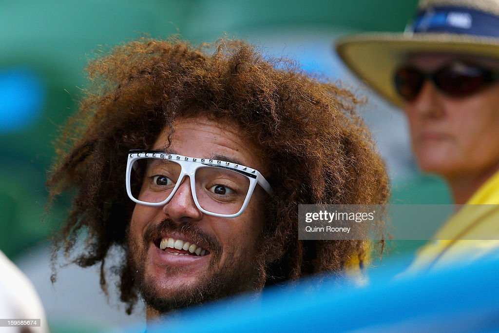 Stefan 'Redfoo' Gordy of the American electro duo LMFAO watches Victoria Azarenka of Belarus and Eleni Daniilidou of Greece in their second round match during day four of the 2013 Australian Open at Melbourne Park on January 17, 2013 in Melbourne, Australia.