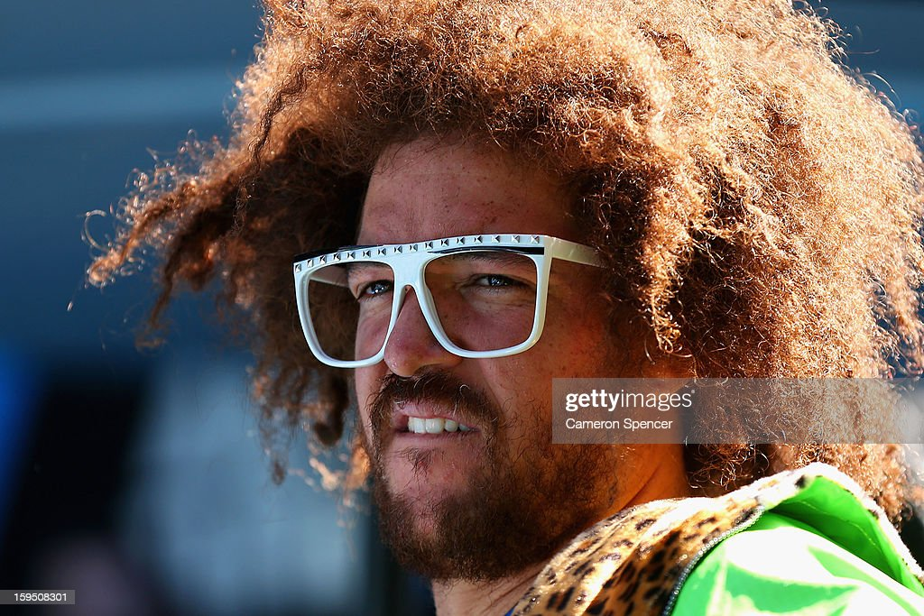 Stefan 'Redfoo' Gordy of the American electro duo LMFAO watches the first round match between Andy Murray of Great Britain and Robin Haase of the...