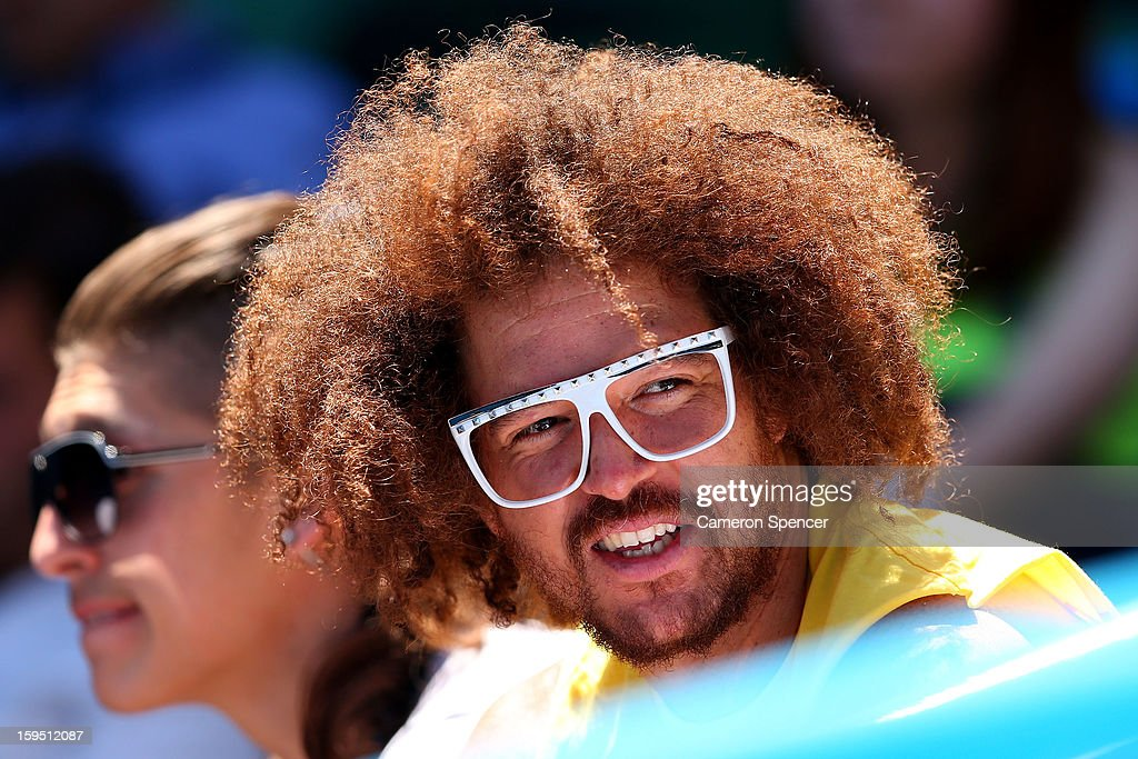 Stefan 'Redfoo' Gordy of the American electro duo LMFAO watches the first round match between Victoria Azarenka of Belarus and Monica Niculescu of Romania during day two of the 2013 Australian Open at Melbourne Park on January 15, 2013 in Melbourne, Australia.
