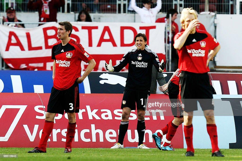 Stefan Reinartz goalkeeper Rene Adler and Sami Hyypiae of Leverkusen react during the Bundesliga match between VfB Stuttgart and Bayer Leverkusen at...