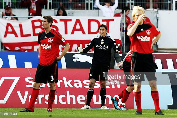 Stefan Reinartz goalkeeper Rene Adler and Sami Hyypiae of Leverkusen react during the Bundesliga match between VfB Stuttgart and Bayer Leverkusen at...