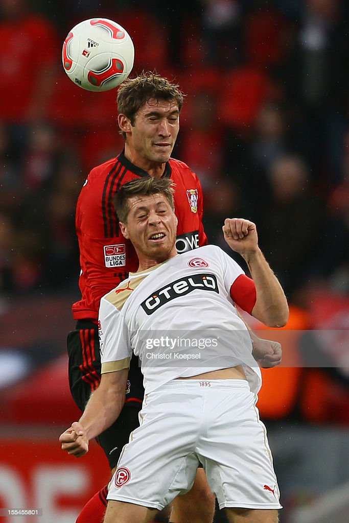 Stefan Reinartz of Leverkusen and Andreas Lambertz of Duesseldorf go up for a header during the Bundesliga match between Bayer 04 Leverkusen and Fortuna Duesseldorf at BayArena on November 4, 2012 in Leverkusen, Germany. (Photo by Christof Koepsel/Bongarts/Getty Images) .