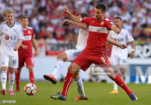 Stefan Reinartz of Leverkusen is challenged by Vedad Ibisevic of Stuttgart during the Bundesliga match between VfB Stuttgart and Bayer 04 Leverkusen...