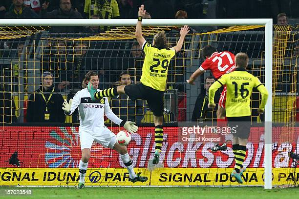 Stefan Reisinger of Duesseldorf scores the first goal against Roman Weidenfeller Marcel Schmelzer and Jakub Blaszczykowski of Dortmund during the...
