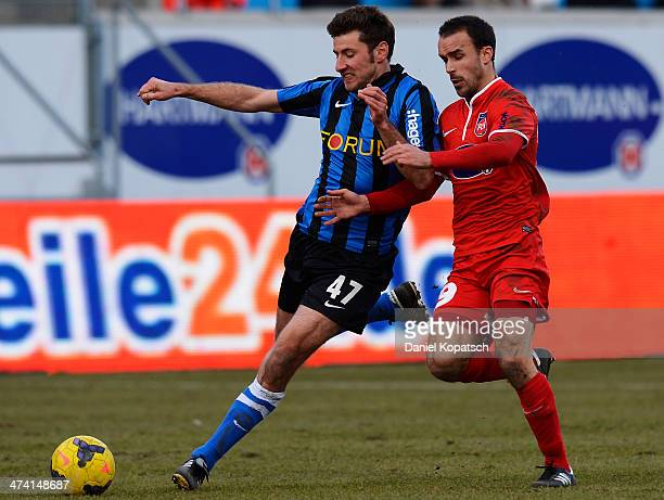 Stefan Reisinger of Saarbruecken is challenged by Robert Strauss of Heidenheim during the third league Bundesliga match between 1 FC Heidenheim and 1...