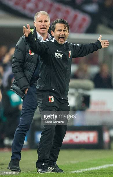 Stefan Reuter and Head Coach Dirk Schuster of Augsburg react during the Bundesliga match between 1 FC Koeln and FC Augsburg at RheinEnergieStadion on...