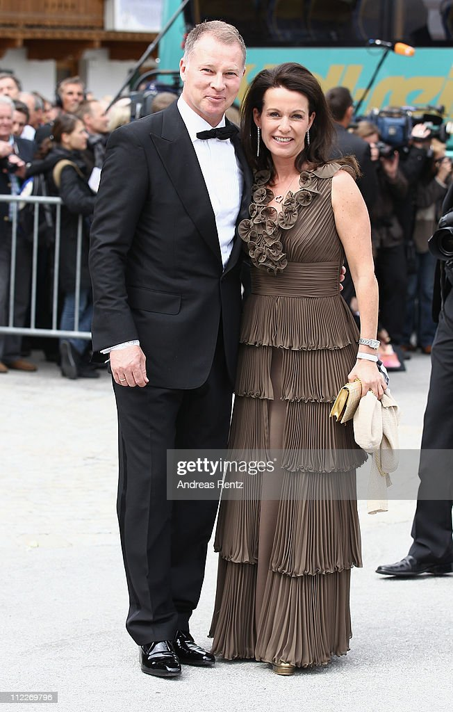 Stefan Reuter and wife Birgit Reuter arrive for the church wedding of Maria HoeflRiesch and Marcus Hoefl at the Pfarrkirche on April 16 2011 in Going...