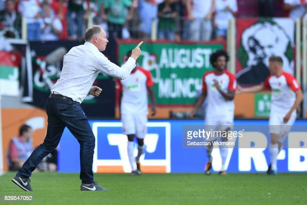 Stefan Reuter manager of Augsburg celebrates his teams second goal during the Bundesliga match between FC Augsburg and Borussia Moenchengladbach at...