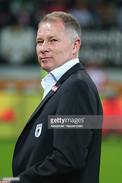 Stefan Reuter manager of Augsburg looks on prior tod the Bundesliga match between FC Augsburg and BVB Borussia Dortmund at SGL Arena on August 29...