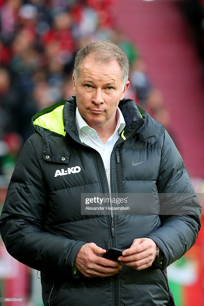 Stefan Reuter manager of Ausgburg looks on prior to the Bundesliga match between FC Augsburg and FC Bayern Muenchen at SGL Arena on December 13 2014...