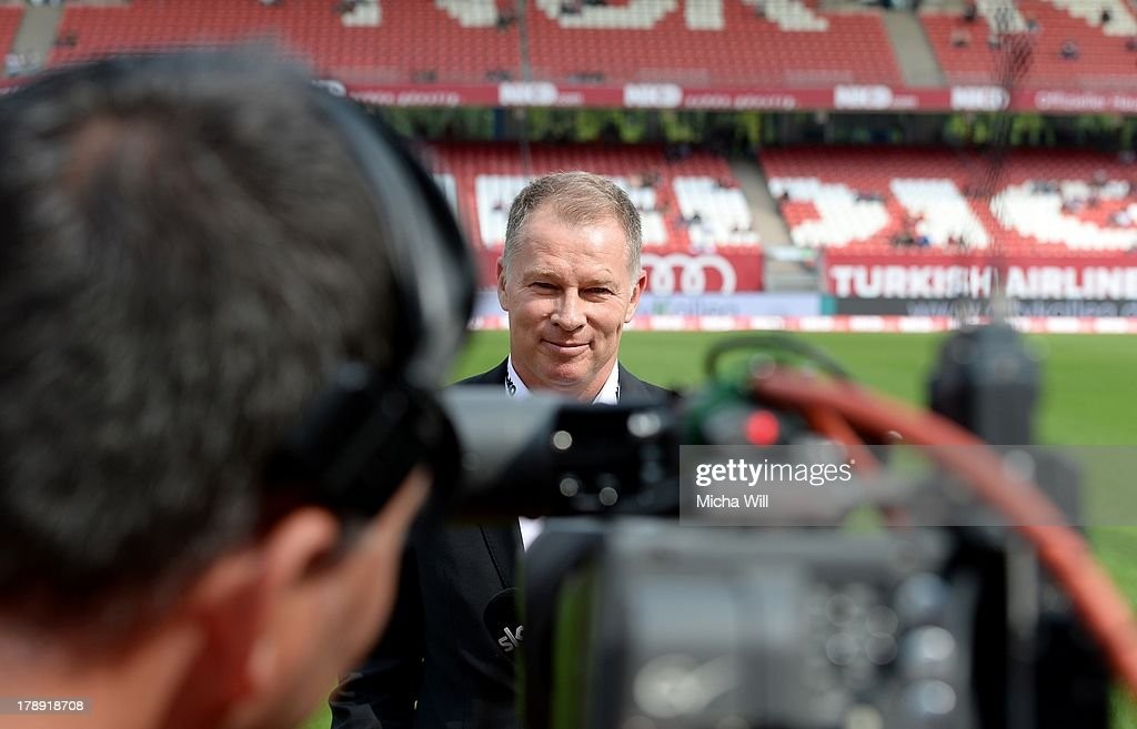 Stefan Reuter of Augsburg is interviewed for TV prior to the Bundesliga match between 1 FC Nuernberg and FC Augsburg at Grundig Stadium on August 31...