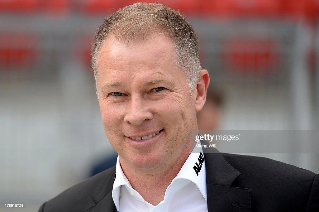 Stefan Reuter of Augsburg smiles prior to the Bundesliga match between 1 FC Nuernberg and FC Augsburg at Grundig Stadium on August 31 2013 in...